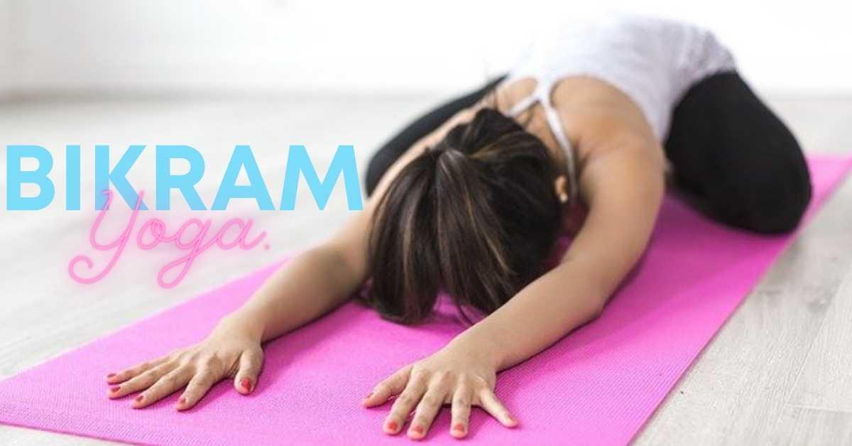 woman in black yoga pants practicing Bikram yoga
