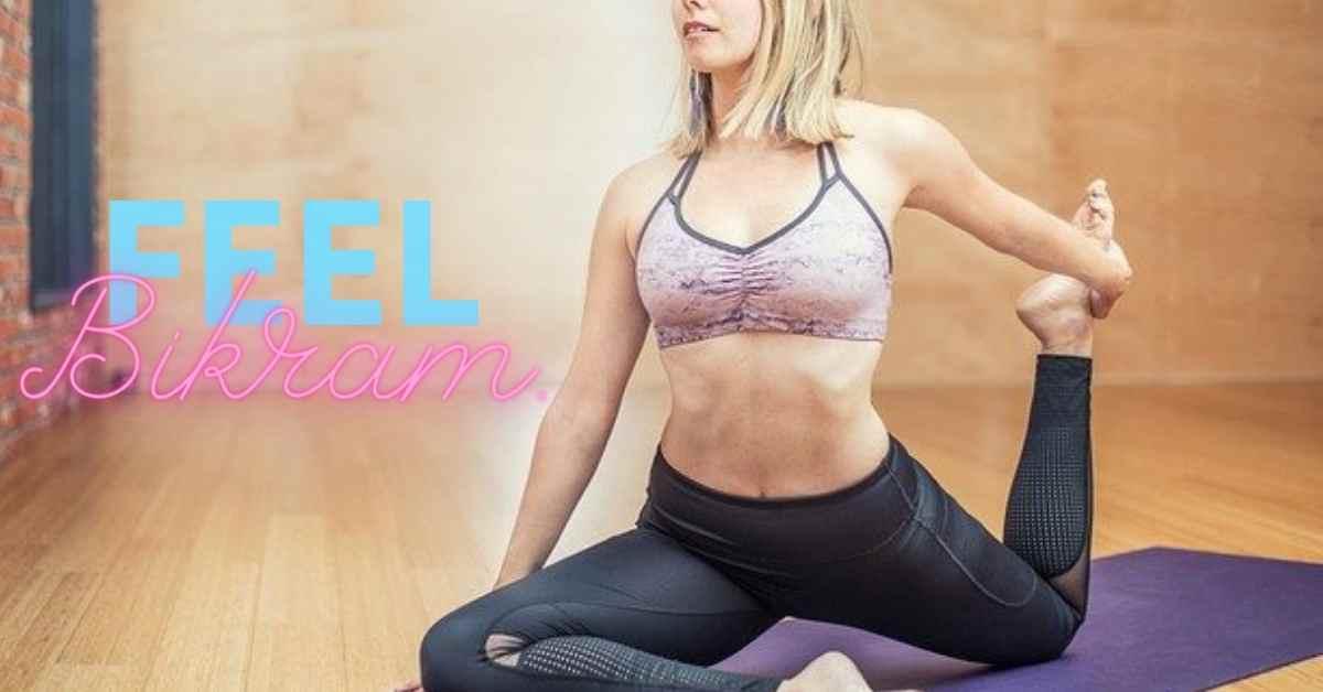 a woman wearing black yoga pbants and a pink psorts bra, practicing bikram yoga in a youga studio.